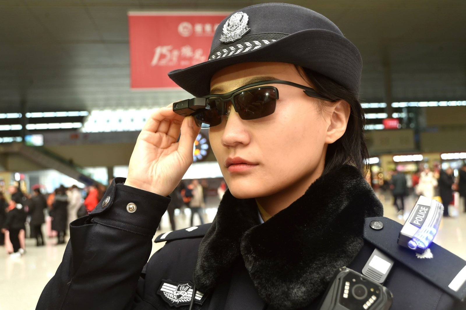 An officer using facial recognition glasses in Beijing